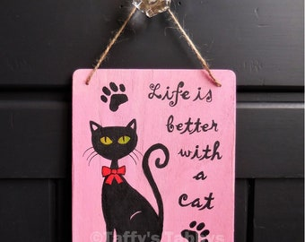 """Original hand painted wooden plaque, """"Life is Better With a Cat"""".  5"""" x 6"""" , black cat with green eyes, red bow, paw print"""