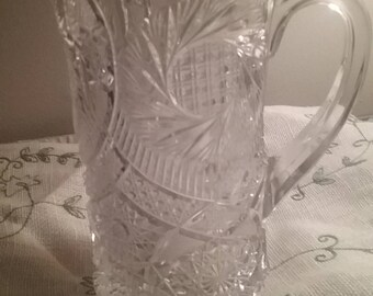 clearance sale, pressed glass pitcher, chip on the bottom of pitcher, hardly noticeable, ornate pitcher,