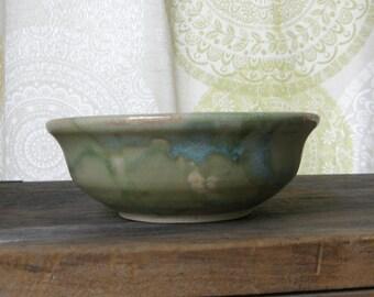 Hand thrown bowl in drippy geeen glaze