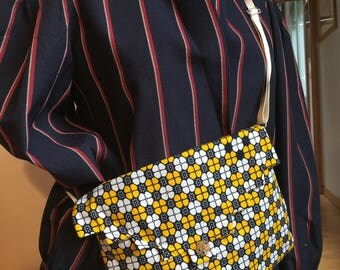 small blue and yellow wax clutch bag