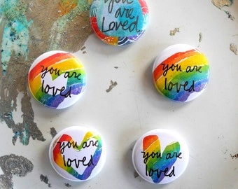you are loved button with pin back - rainbow - single blessing button