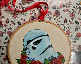 Original Painting of Star Wars Stormtrooper Helmet with roses on beige painted on a 5 inch round embroidery hoop with red ribbon for hanging