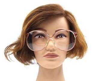 deadstock vintage. round eyeglasses. oversize eyeglasses. eyeglasses frames. clear plastic. red wine. silver metal. made in w germany. 278