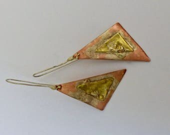 Three metals. Earrings in copper, silver and bronze clumps.