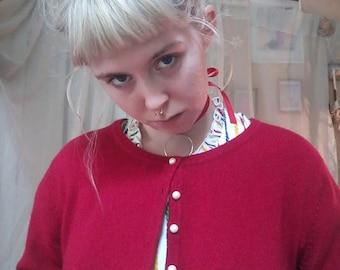 soft red cardigan
