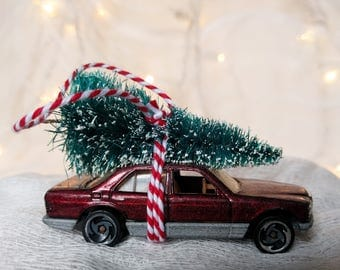 Burgundy Classic Car with Tree Strapped to the Top Ornament by Distinguished Flamingo