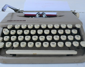 vintage Tower Attache typewriter, manual, sand color, needs work,from Diz Has Neat Stuff