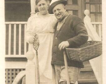 "Vintage Snapshot ""Gentleman Farmer"" Garden Basket Wellington Boots Pitchfork Wife Holding Rug Beater Found Vernacular Photo"