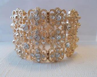 Gold Tone Stretch Cuff Bracelet with Clear Rhinestones