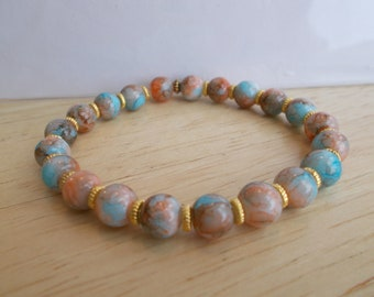 Stretch Bracelet made with Multi Color Marbled Glass Beads and Gold Tone Spacer Beads