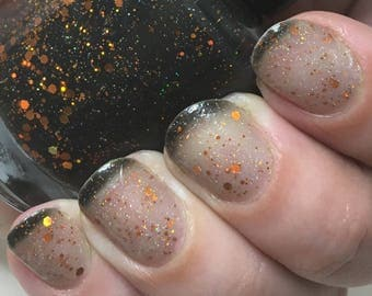 The Maze Nail Polish - thermal black-to-clear with copper holo glitter