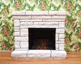White faux stone electric fireplace and mantel