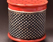 Medium Covered Jar, Black Stain on Unglazed Exterior with Textured Squares With Shiny Red Glaze