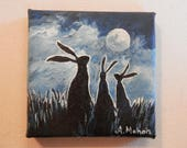 "Original painting: ""Worlds of wisdom"", two young hares sit listening to a larger hare in the light of a full moon, hand painted mini canvas"