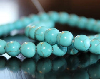 50 synthetic turquoise beads, dyed, round and smooth, 8 mm, 1 mm hole