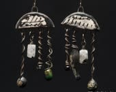 Rainmaker, rustic ceramic chandeliers festooned with artisan dangles of glass on wire, enamel and moonstone, black and white earrings