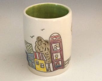 Story Cup, green. Cat in the Blue House.