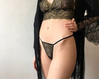 All That Glitters, Stunning Black and Gold Threaded Lace Sheer Triangle Invisible Thong with Swarovski Crystal detail