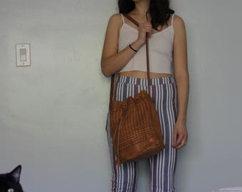 Vintage woven leather drawstring bucket bag