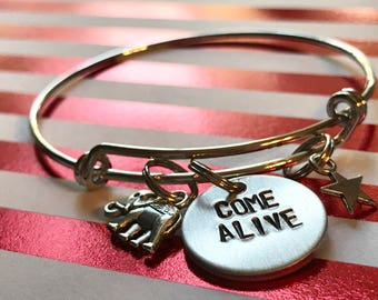 """Greatest Show Man Inspired Hand-Stamped Bangle Bracelet - """"Come Alive"""""""