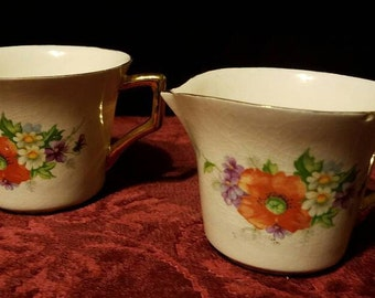 REDUCED! Porcelain cream and sugar set with a poppy floral decal on the side, Kleine Co. porcelain cream and sugar set, serving set, gold