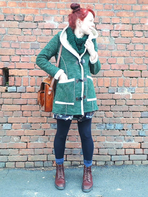 The Billie coat, jacket in green with wool-look lining.
