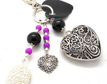 A scent! silver plated bag charm, purple and black heart charms