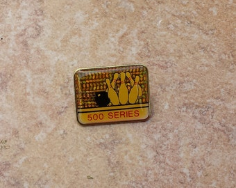 Bowling 500 Series Pin Brooch Vintage Gold Tone Yellow Blackwith Sparkly Reflective Background Bowling Ball and Pins, Lapel Pin