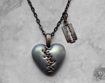 Gothic 'This Love' stapled loveheart & razor blade necklace / Silver tone + copper heart + gunmetal chain / Macabre Horror Punk Goth jewelry