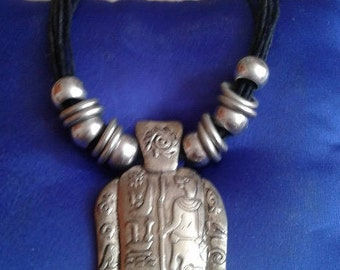 Lucky necklace with hieroglyphic writing.
