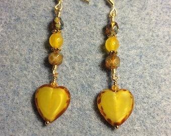 Yellow Czech glass heart bead dangle earrings adorned with yellow Czech glass beads.