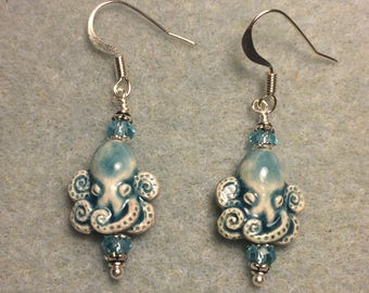 Turquoise ceramic (raku) octopus bead earrings adorned with turquoise Chinese crystal beads.