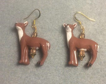 Brown and white ceramic deer bead earrings adorned with brown Czech glass beads.