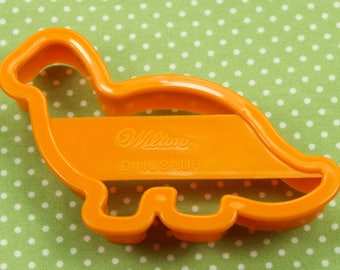 Collectable 1993 Wilton Orange Plastic Dinosaur Cookie Cutter USA