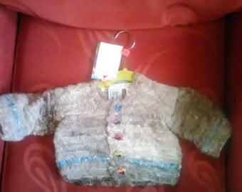 Hand knitted Cardigan, knitted in home spun wool to fit a baby aged 0-3 months old