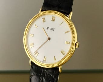 Elegant PIAGET Vintage Watch in 18kt gold with manual winding with boxes and documents, excellent condition.