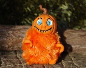 Doll pumpkin. Pumpkin Troll . A doll for Halloween. Pumpkin with eyes for Halloween. Miniature pumpkin. Halloween.