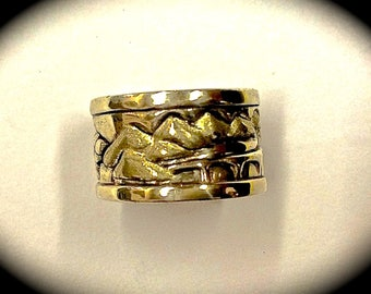 custom carved continuous scene wedding band with mountains, lake, bridge and butterfly on back