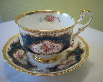 Paragon teacup and saucer,full size,fine bone china,made in England,By Appointment to her Majesty the Queen,ornate,gold trim,teal and pink