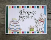Birthday card - with chef, present and enormous iced cake, handstamped and coloured die cut card with multicoloured striped background