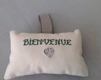 Welcome door pillow with silver metal heart