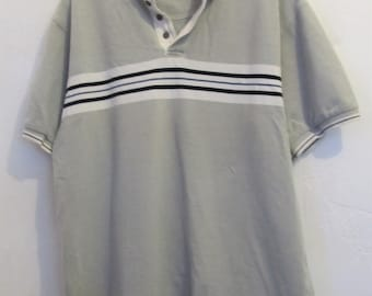 A Men's Vintage 90's,Gray Short Sleeve Polo Shirt With Chest STRIPE By Trader Bay.M