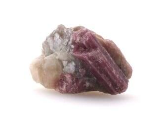 Raw pink tourmaline with lepidolite mica on quartz , natural pink tourmaline crystal
