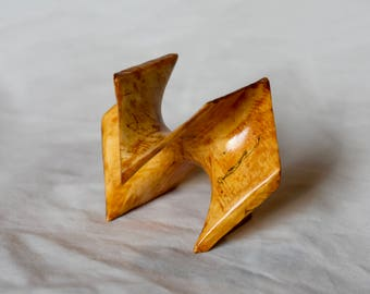 Schwarz D surface sculpture. Minimal surface cubic cell in spalted birch