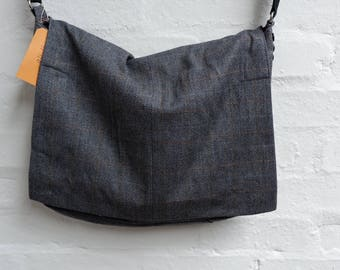 Over-the-shoulder messenger bag. Made from a recycled mans suit jacket. Lovely charcoal grey herringbone pattern.