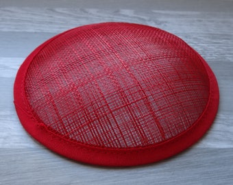 Round base curved red sinamay hat or fascinator
