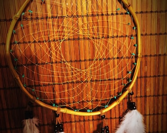 Handmade Bamboo Dreamcatcher with natural sinew, turquoise rocks, feathers and wooden beads