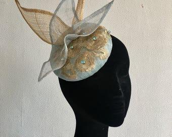 Small pillbox button hat fascinator pale blue antique gold 3D bow lace royal ascot fascinator