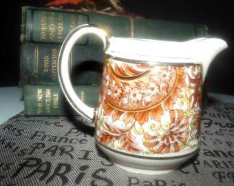 Early mid-century (c.1940s) Sadler England 3484 hand-decorated mini creamer | milk jug. Orange, brown, gold brocade pattern, gold edge.