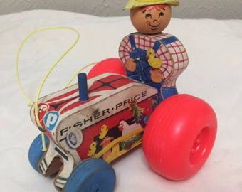 Vintage fisher price farmer pull toy